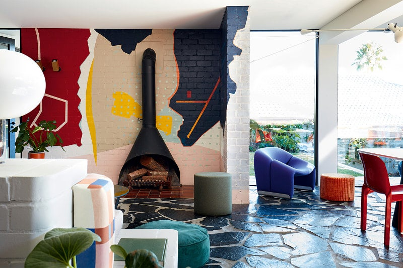 big mural behind fireplace
