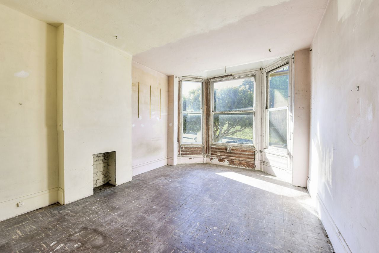 open empty room with large bay window
