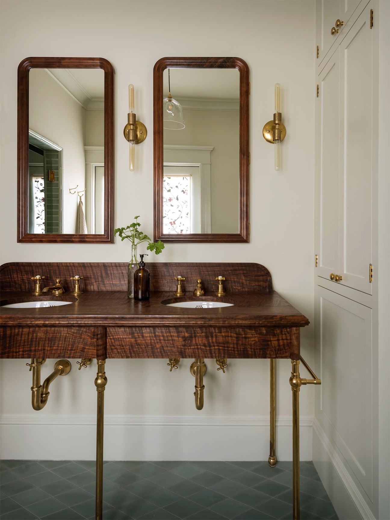 bathroom sink with dark wood