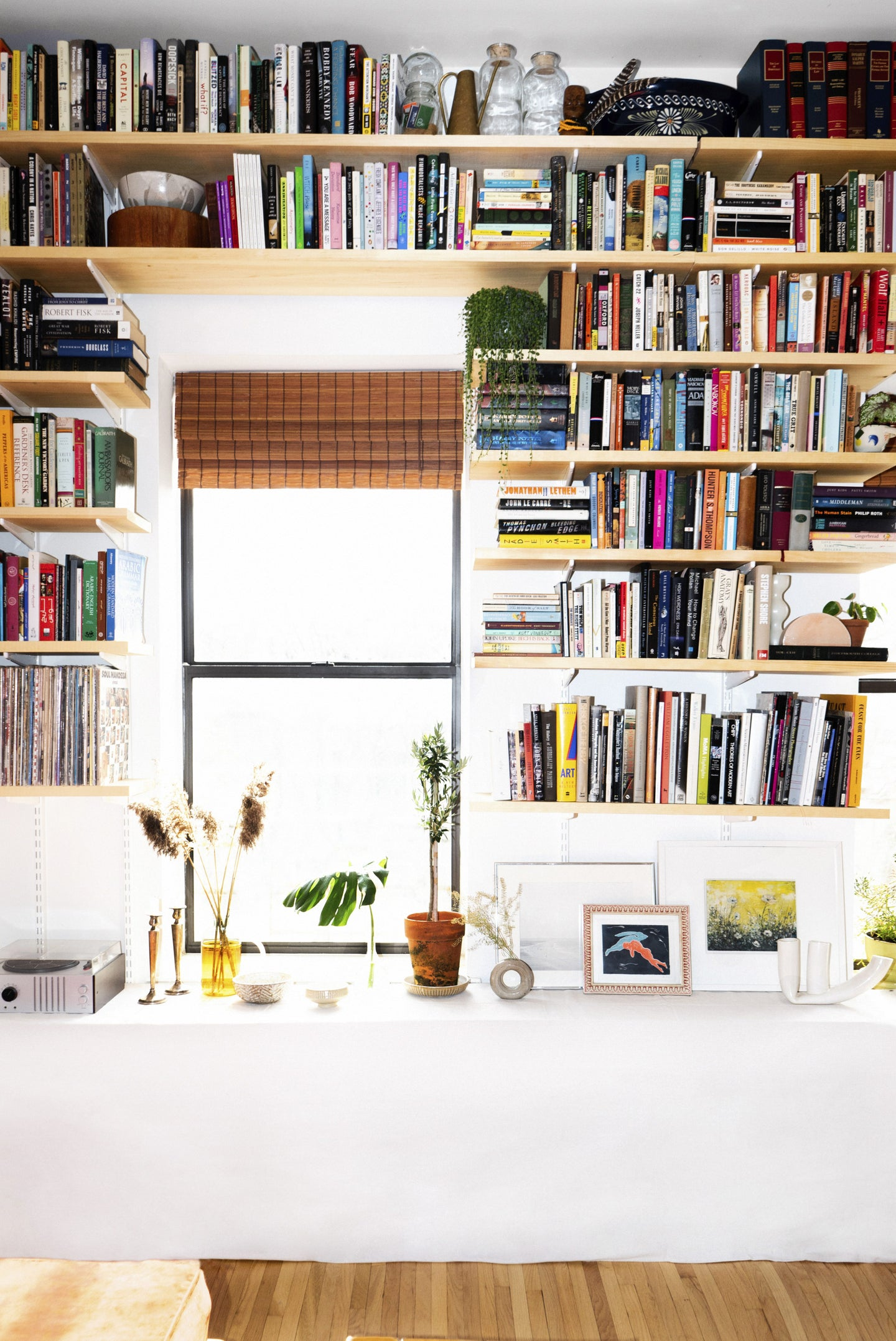bookshelves with two windows in between