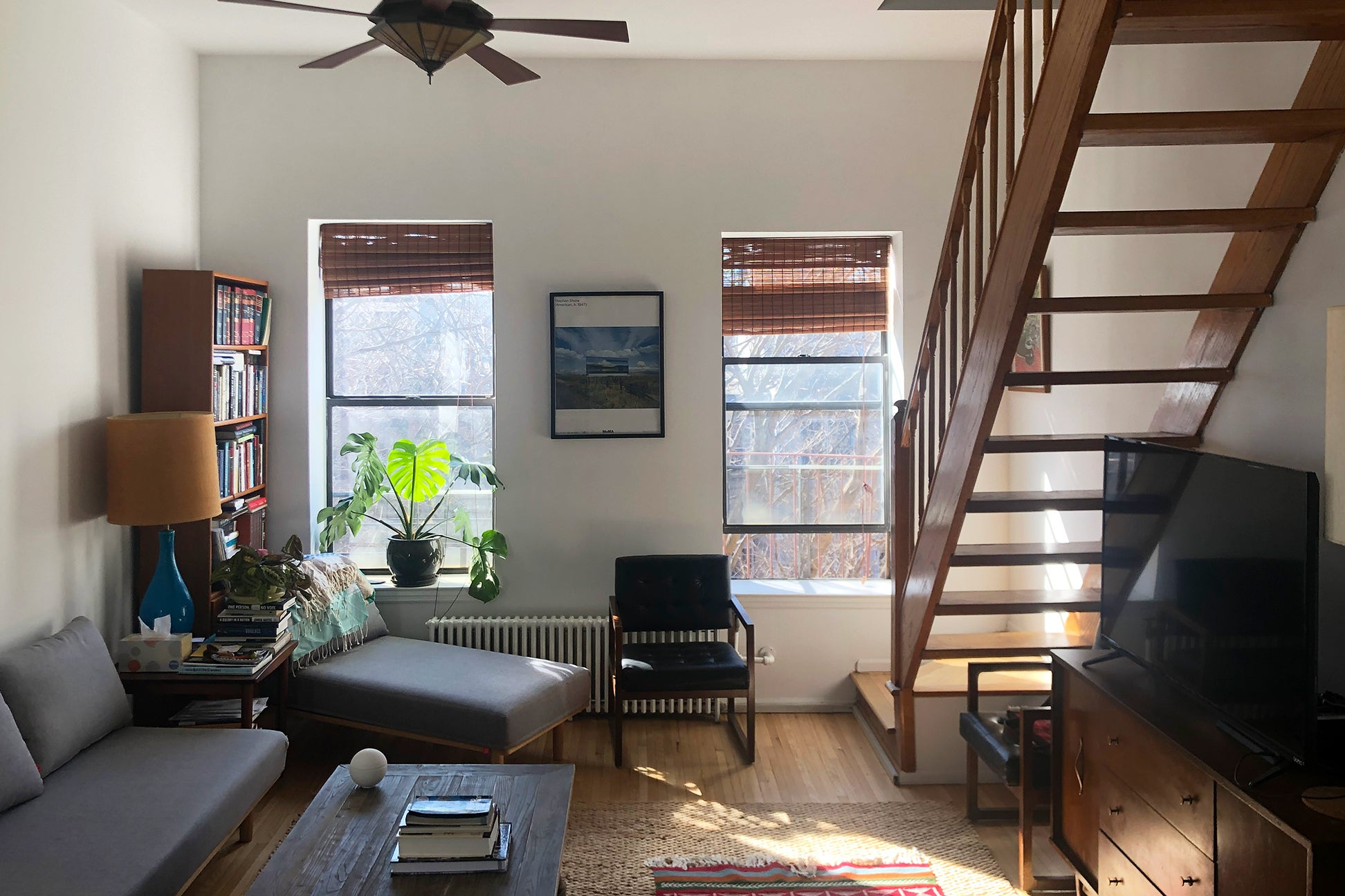 before image of a living room with wood stairs