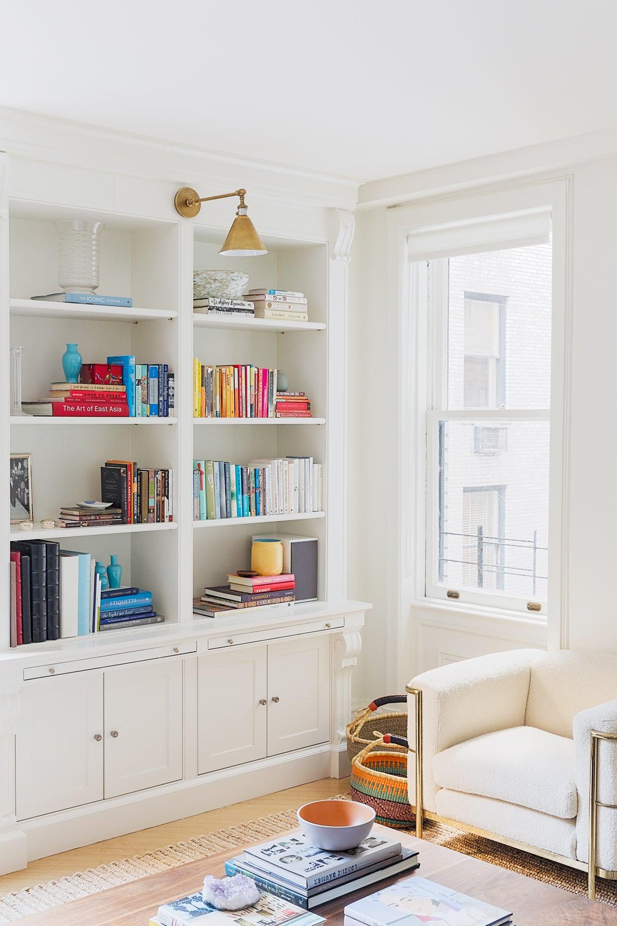 White apartment with bookshelves
