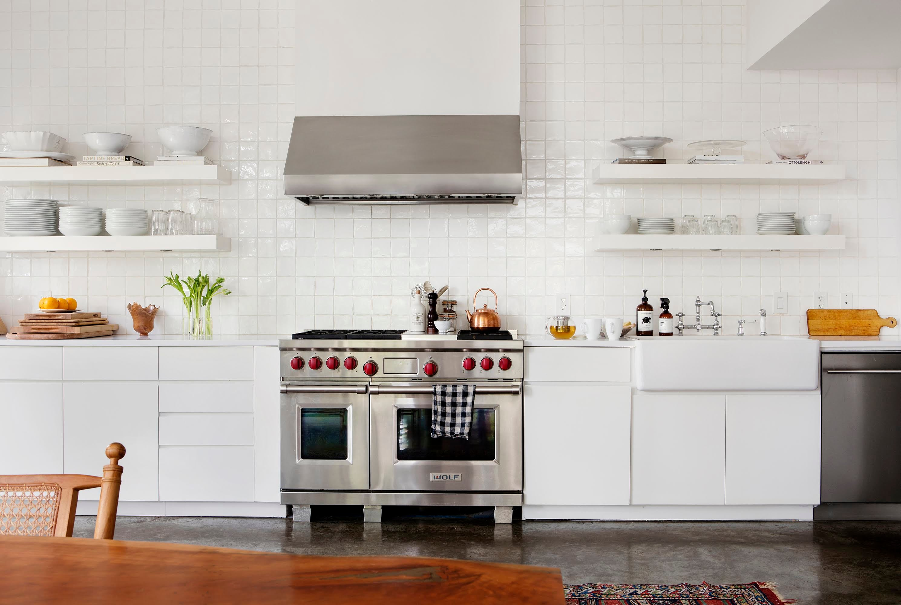 white kitchen with large steel range