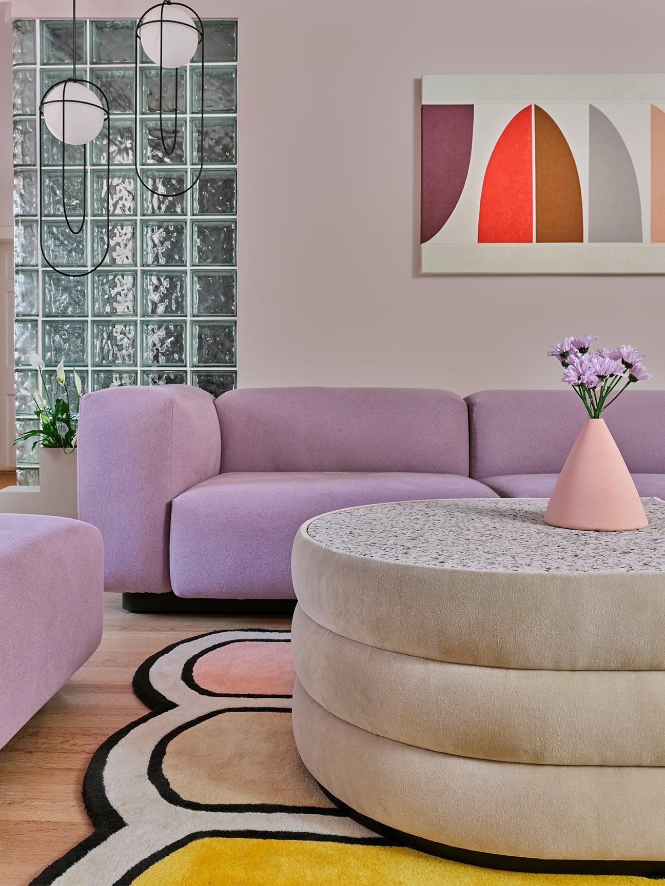 Lilac sofa and wavy rug