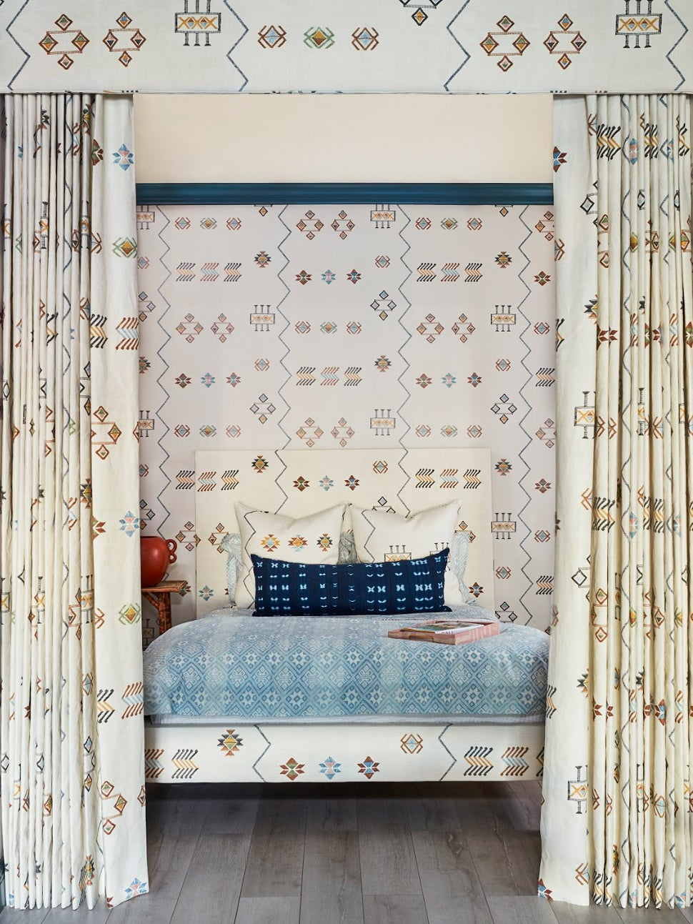 white boho canopy bed with matching wallpaper