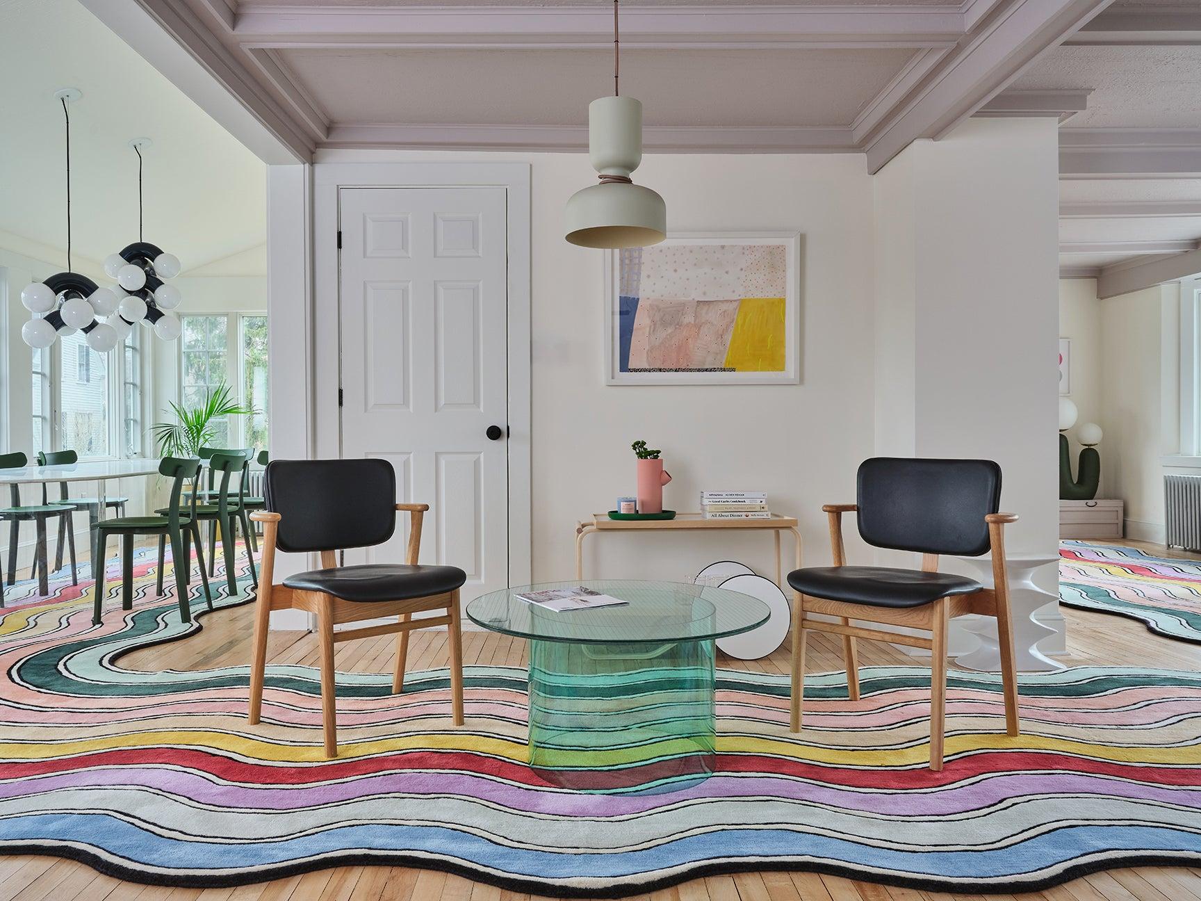 wavy rainbow rug that wraps in a horseshoe