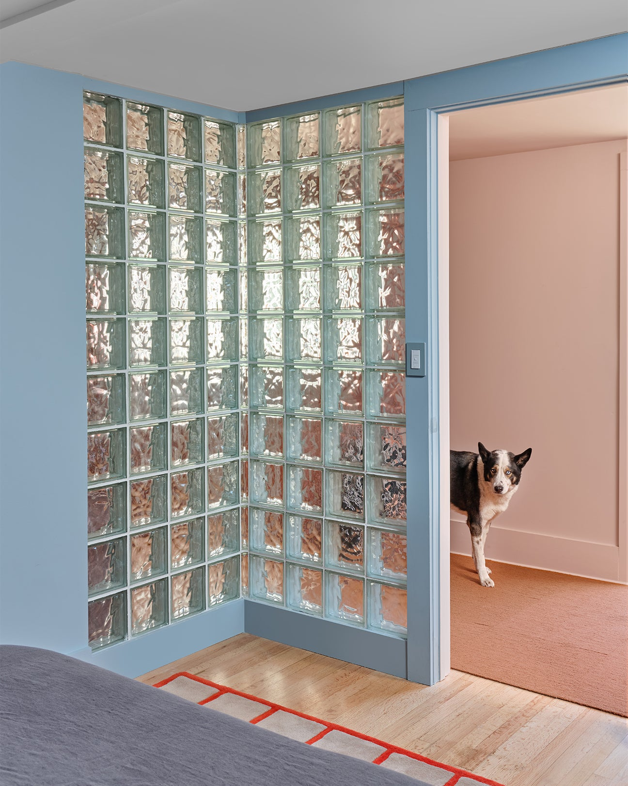 corner of a bedroom covered with glass blocks