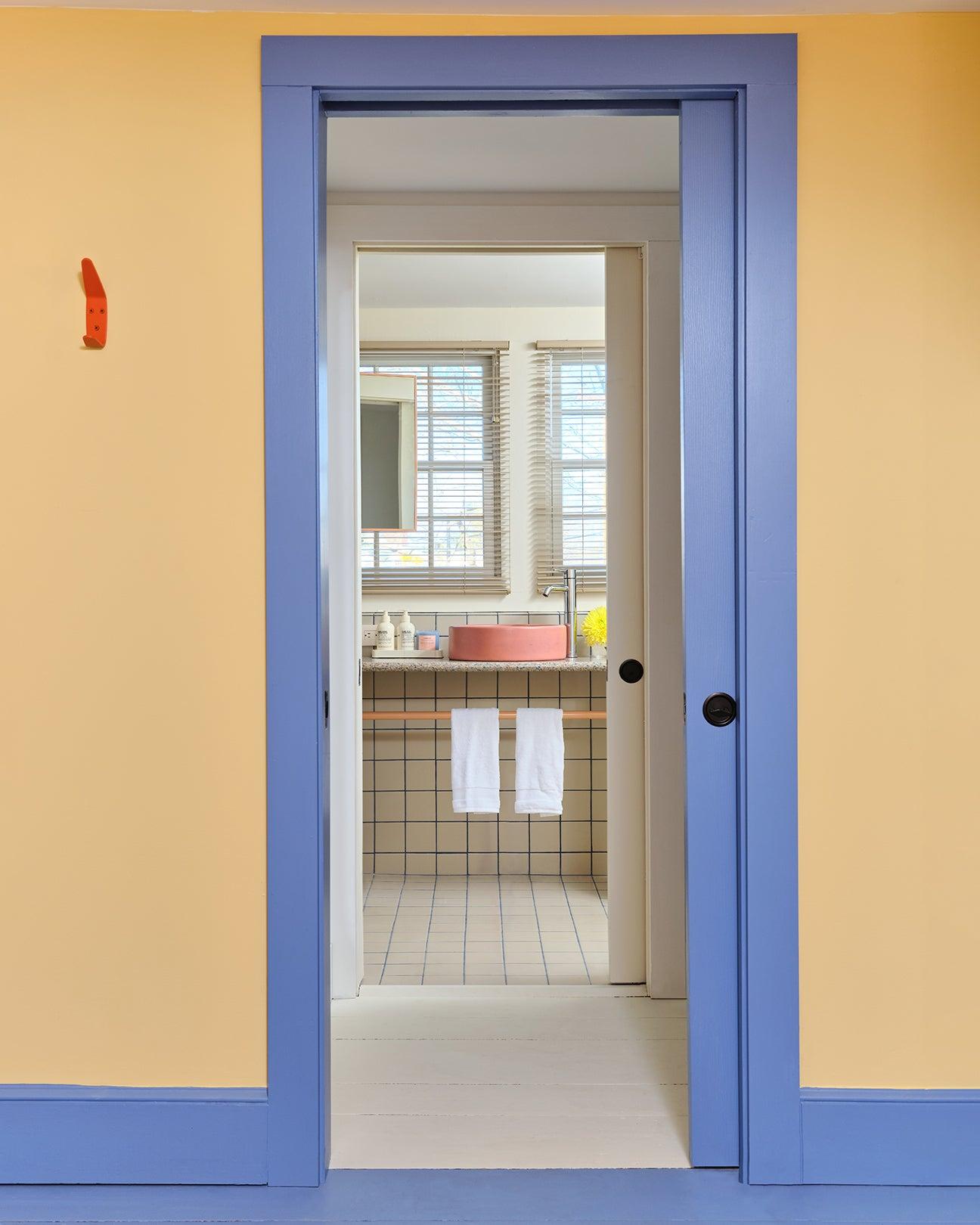 purple door frame and yellow walls