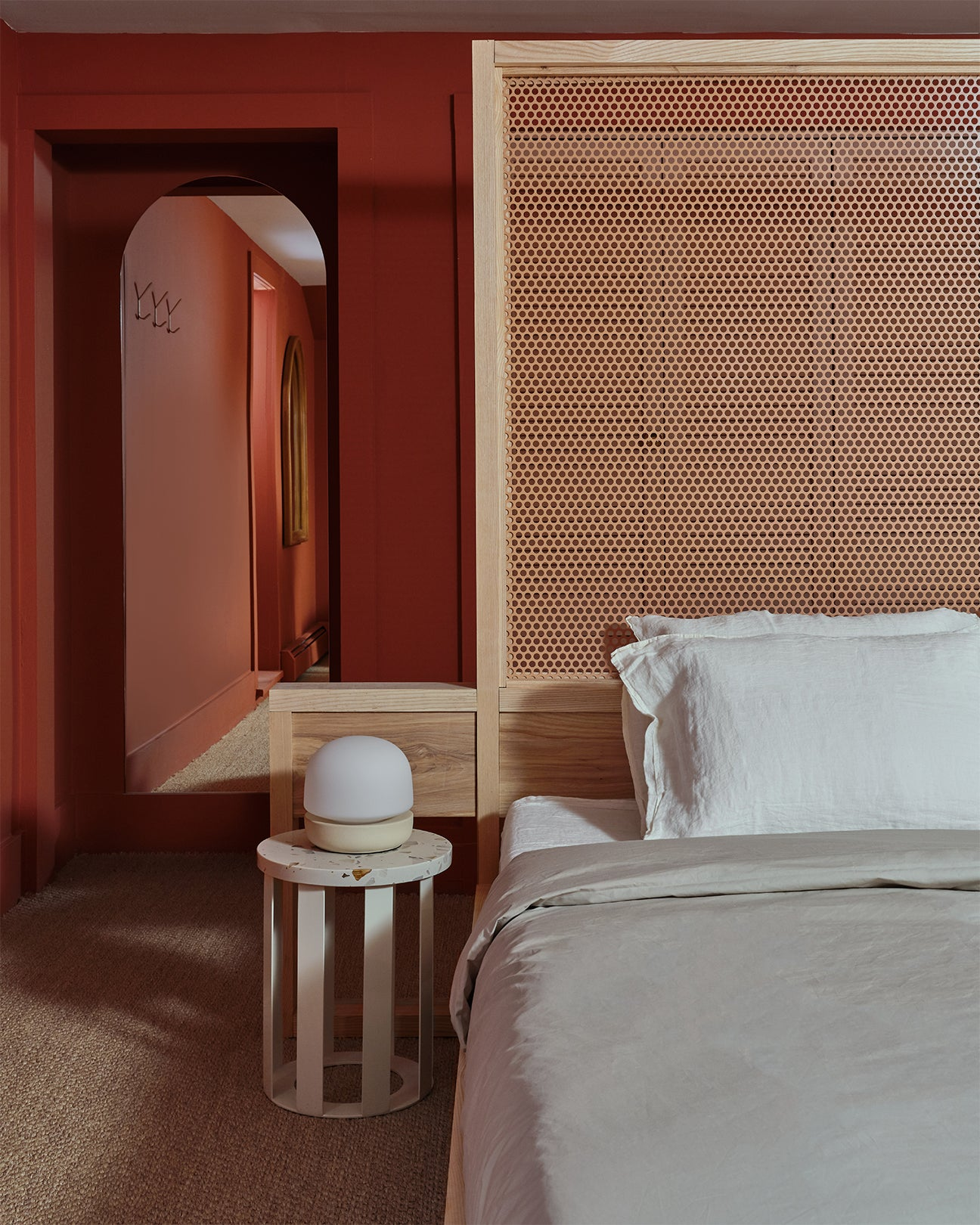 red room with a tall wood headboard