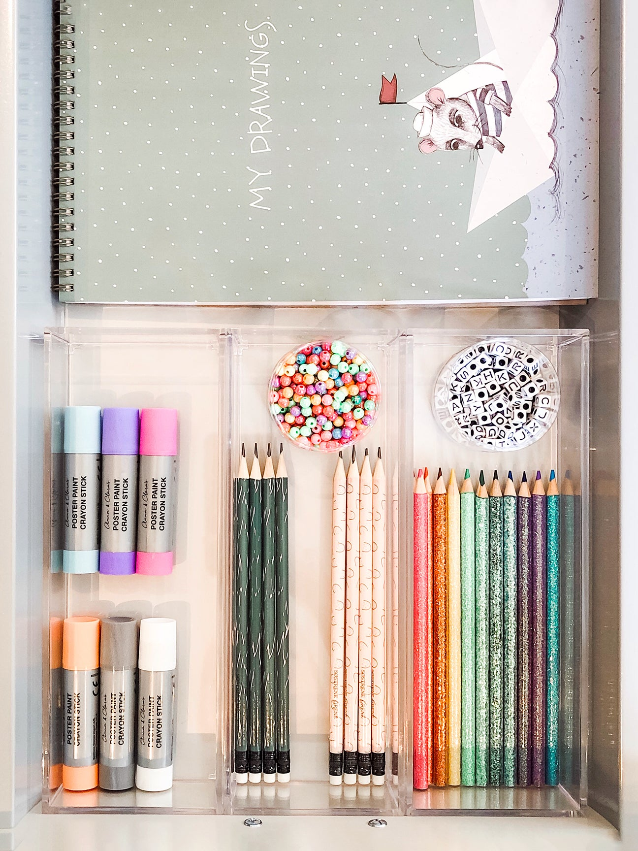 pencils lined up in a drawer