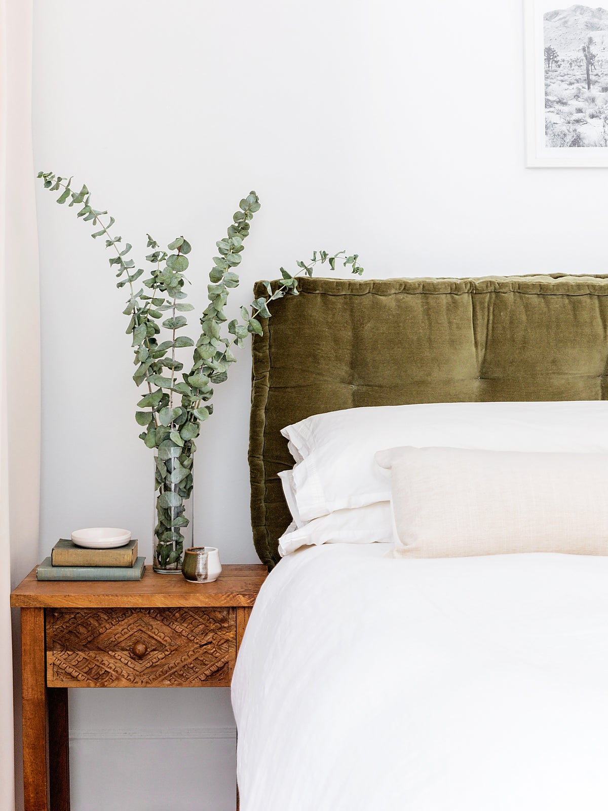 Bedroom with green velvet headboard