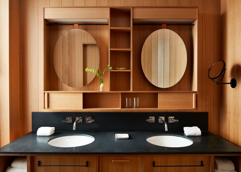 double vanity in wood panel bathroom