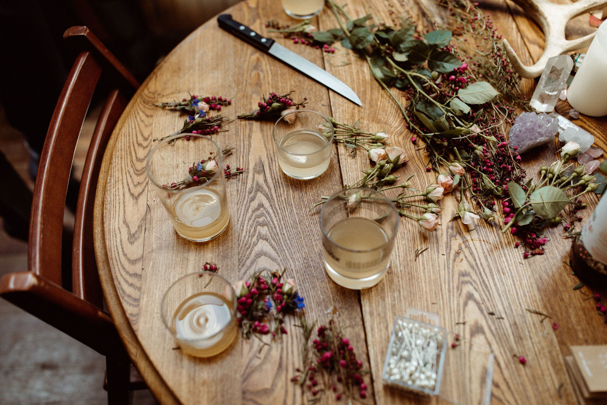 table covered in flowers and drinks