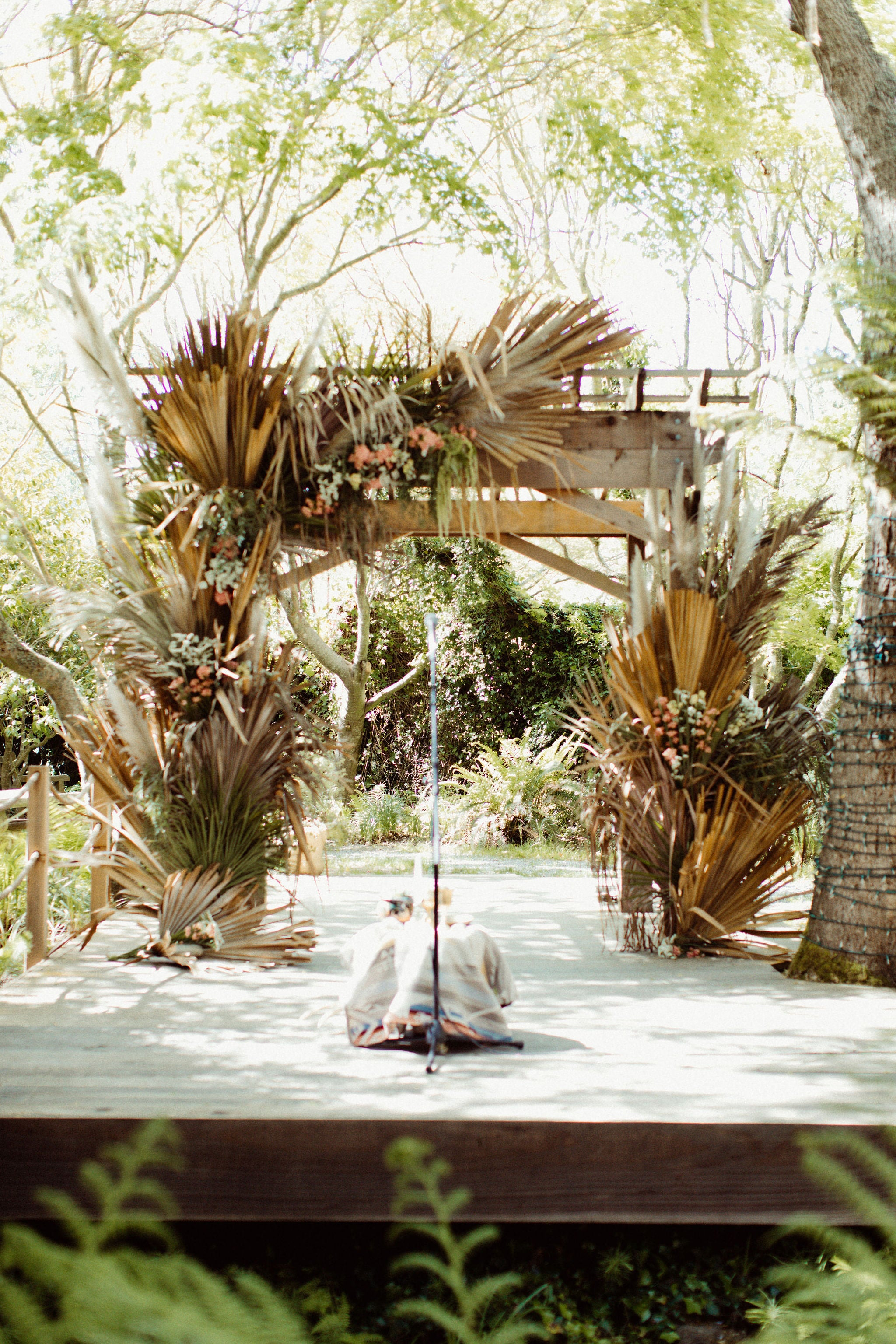 wedding altar covered in palm leaves