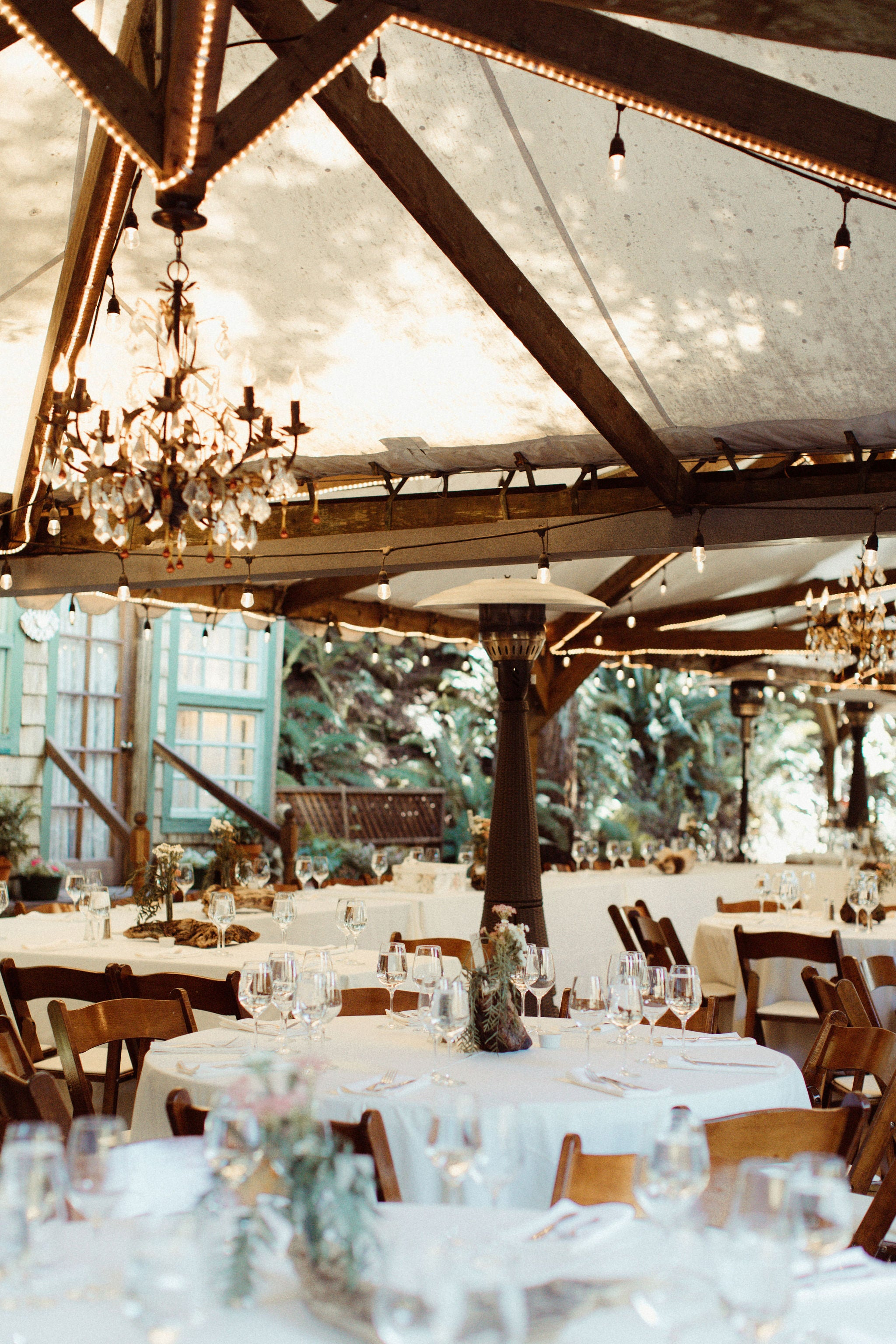tent with white linen tables