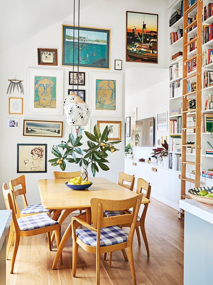 dining room with large gallery wall