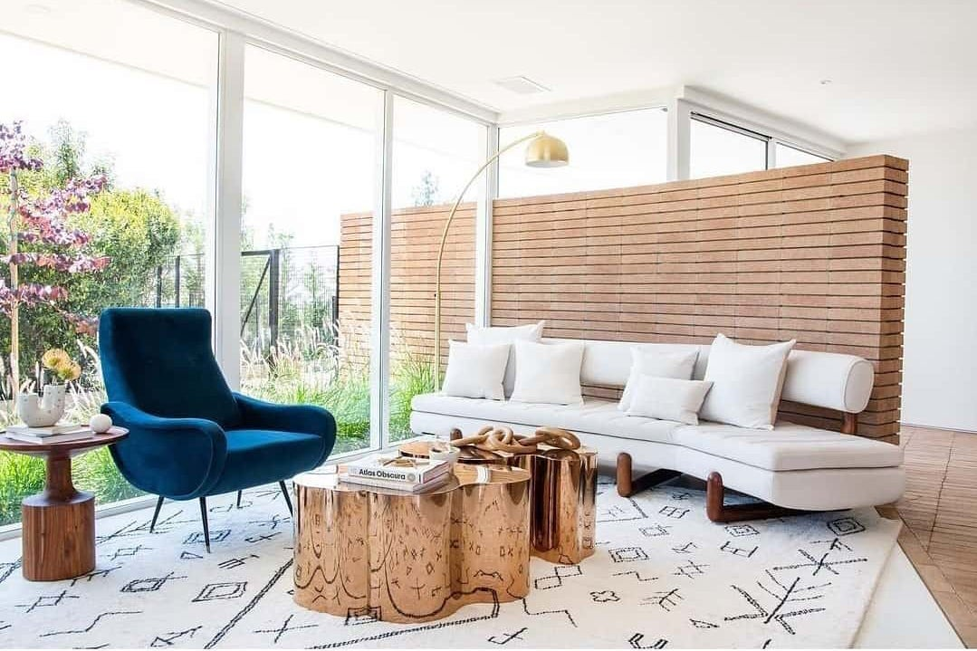 brick wall in a glam mid century living room