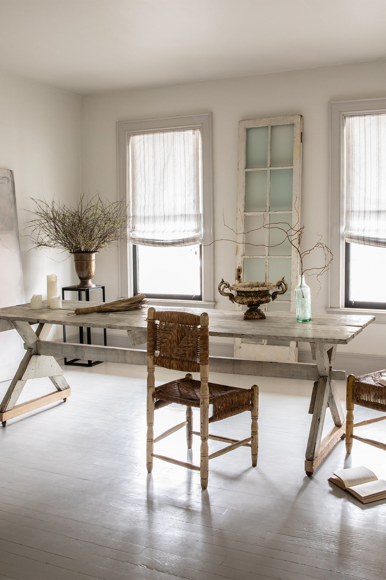 white dining room with rustic furniture