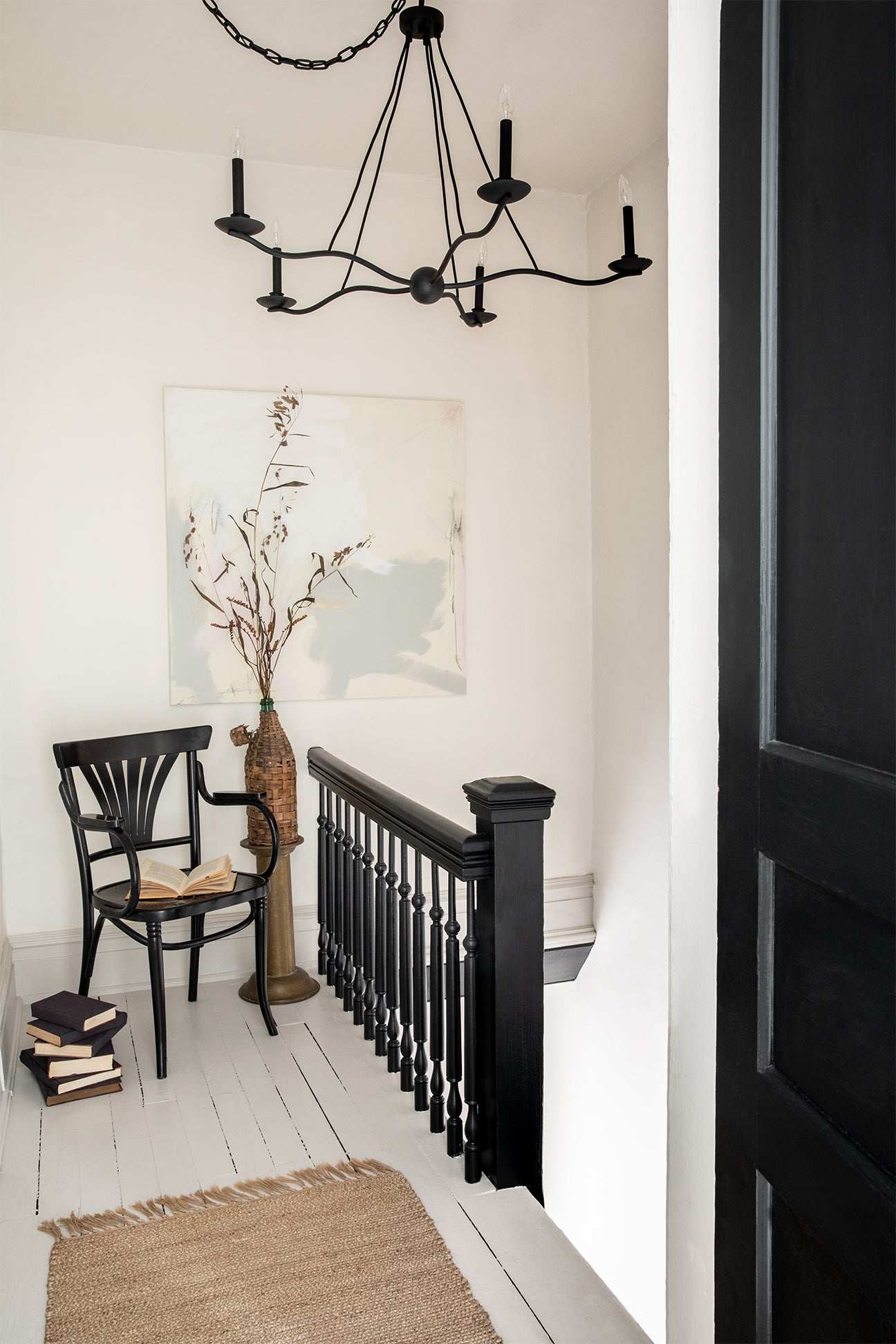 hallway with black staircase