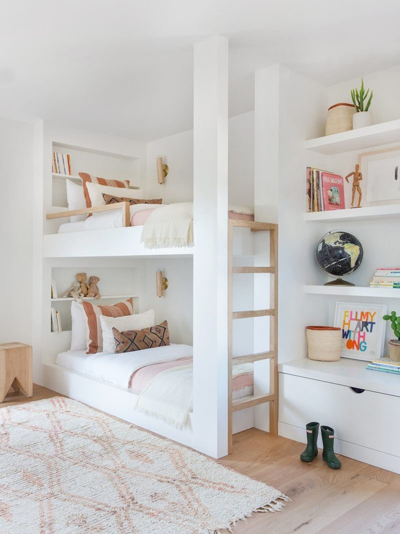 white kids bedroom with bunk beds and pink bedding