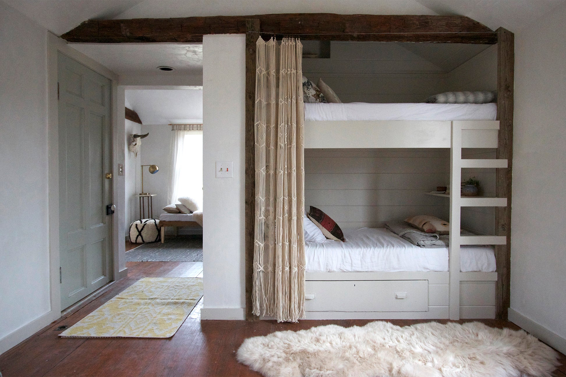 rustic grey bedroom with bunkbed and curtain