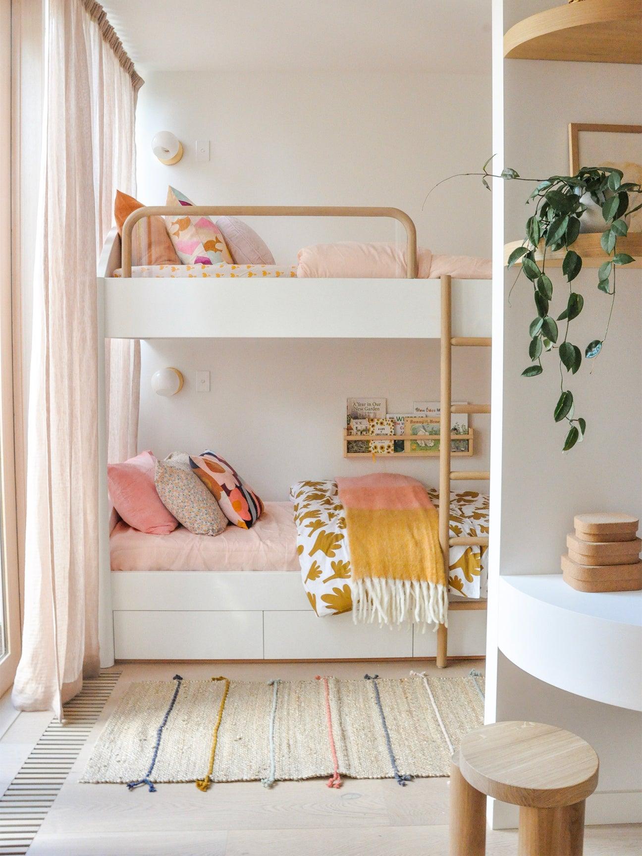 pink and orange kids bedroom with bunk bed