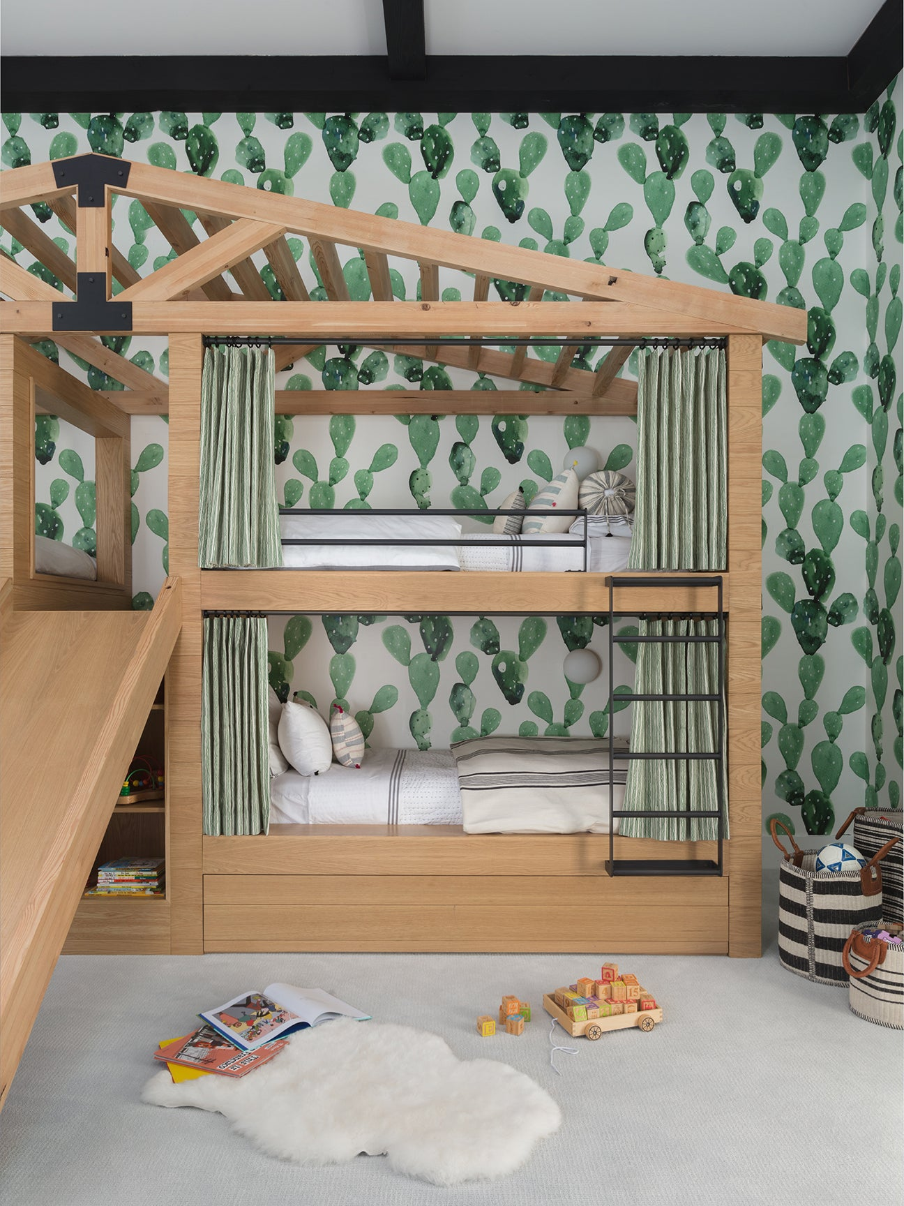 house-shaped bunkbed with cactus wallpaper