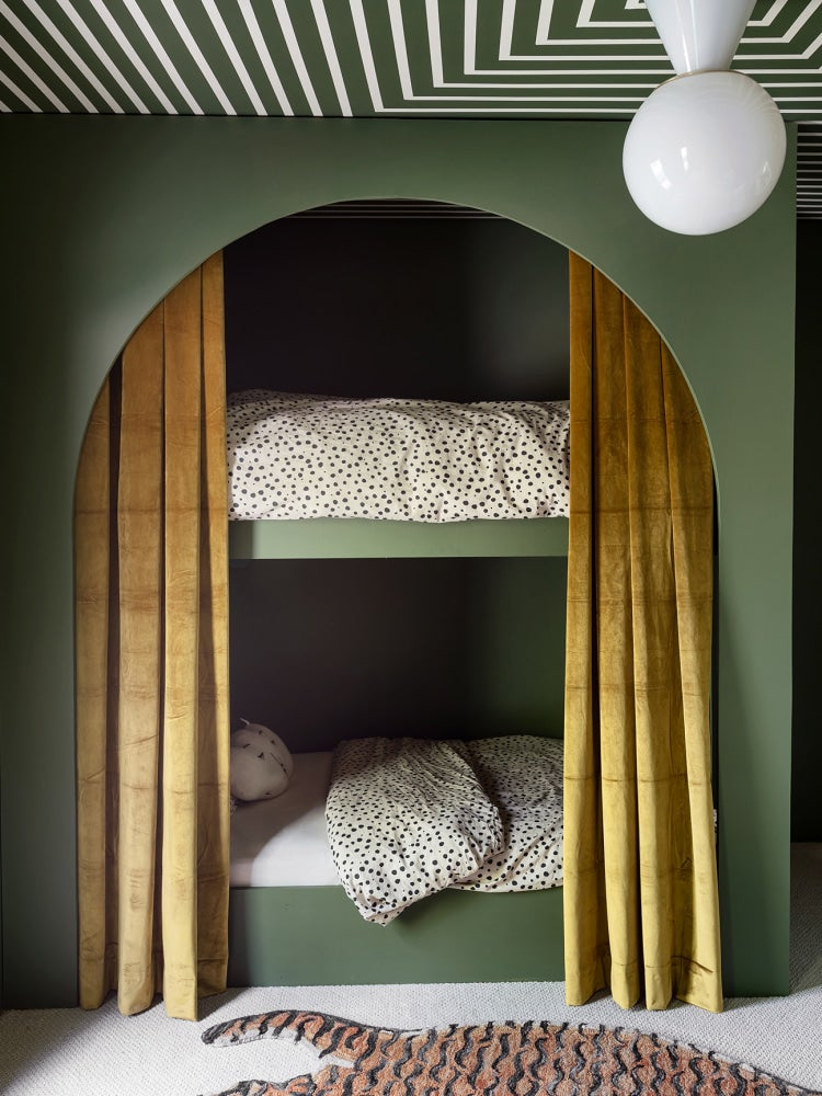 green arched bunk beds with gold curtain