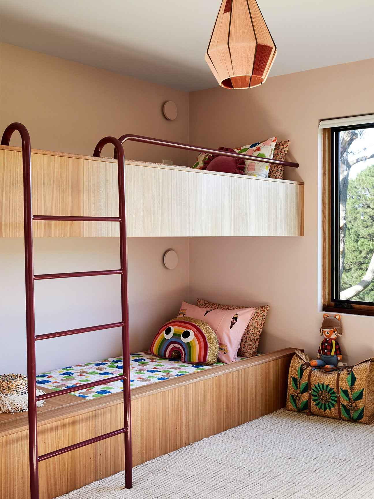 wood bunk beds with red ladder