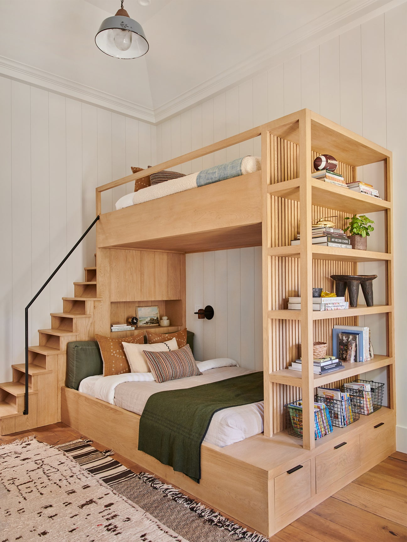 wooden bunk bed with bookshelf and stairs