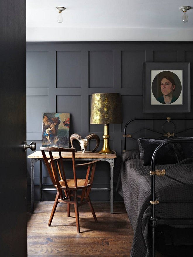 matte black wood panel bedroom
