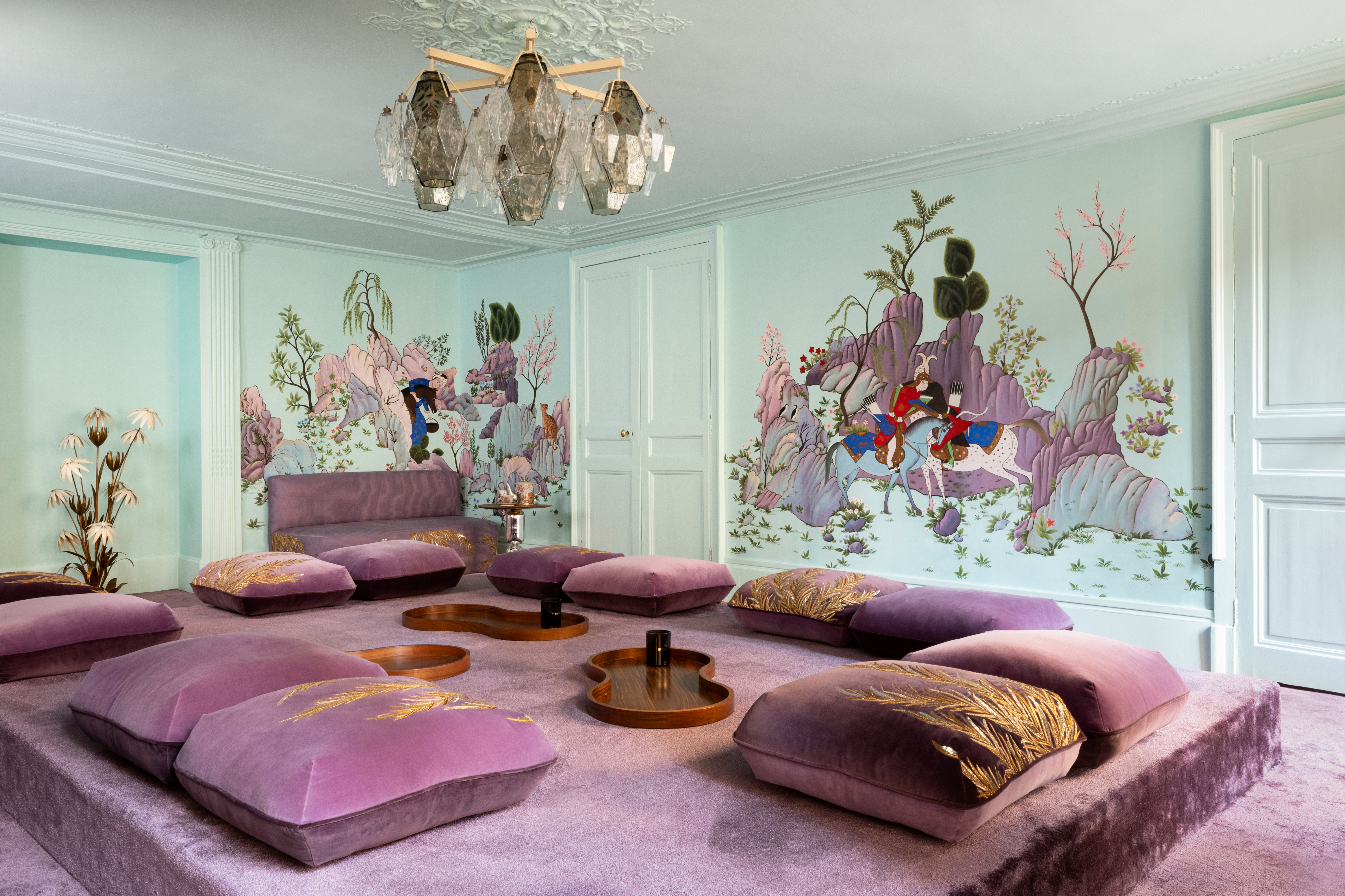 purple rug and light blue walls with graphic wallpaper