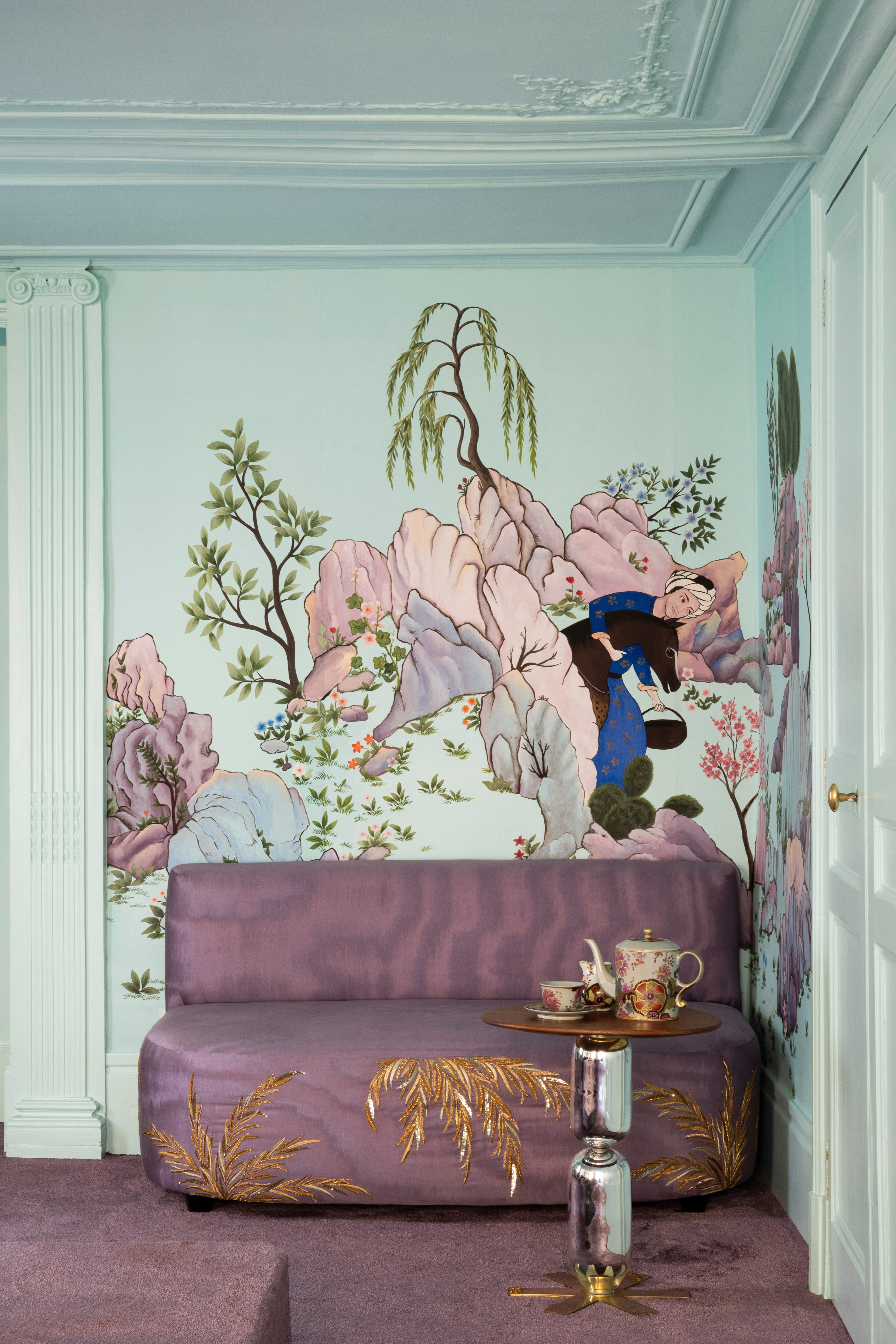 floral wallapper and purple couch