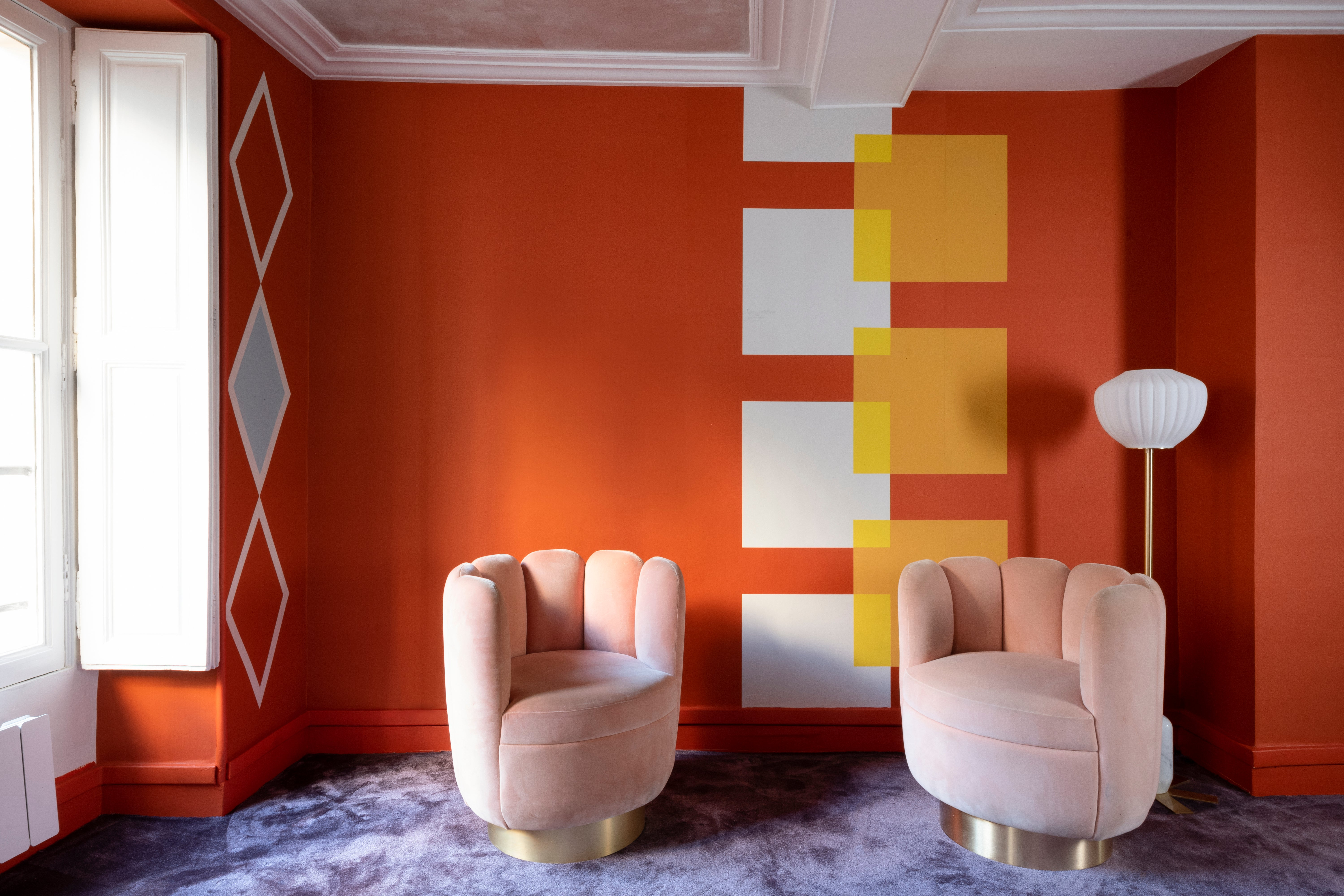 orange walsl and pink swivel chairs