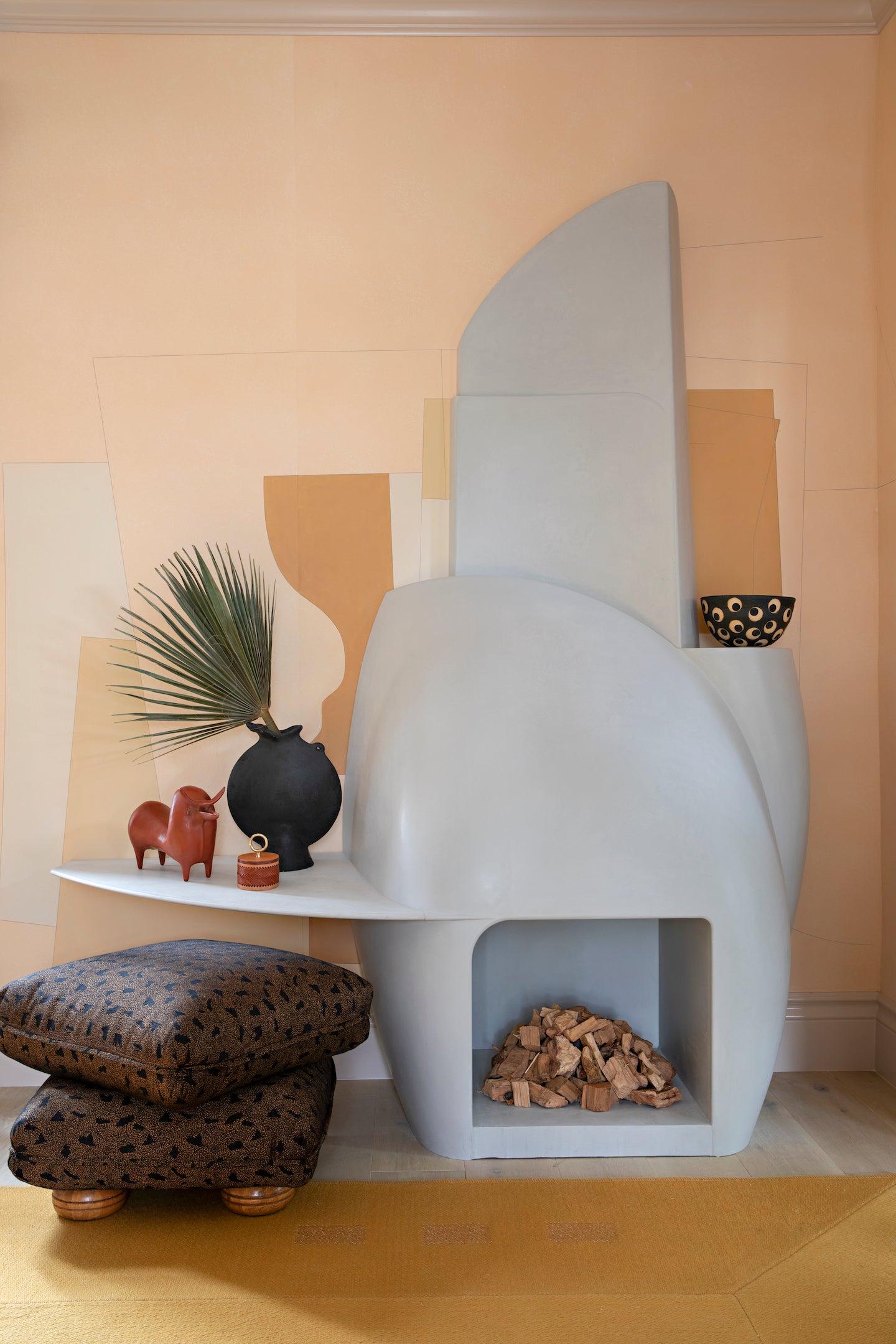 sculptural plaster fireplace with ah shelf