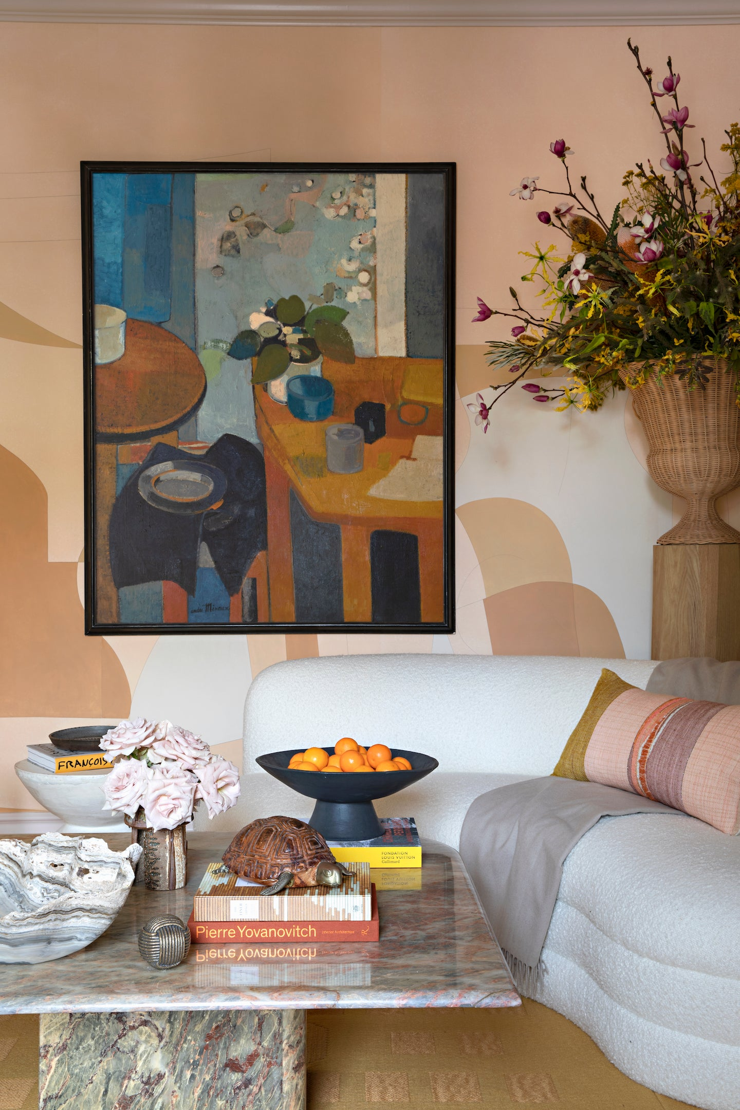 curved whie sofa and large abstract painting on wall