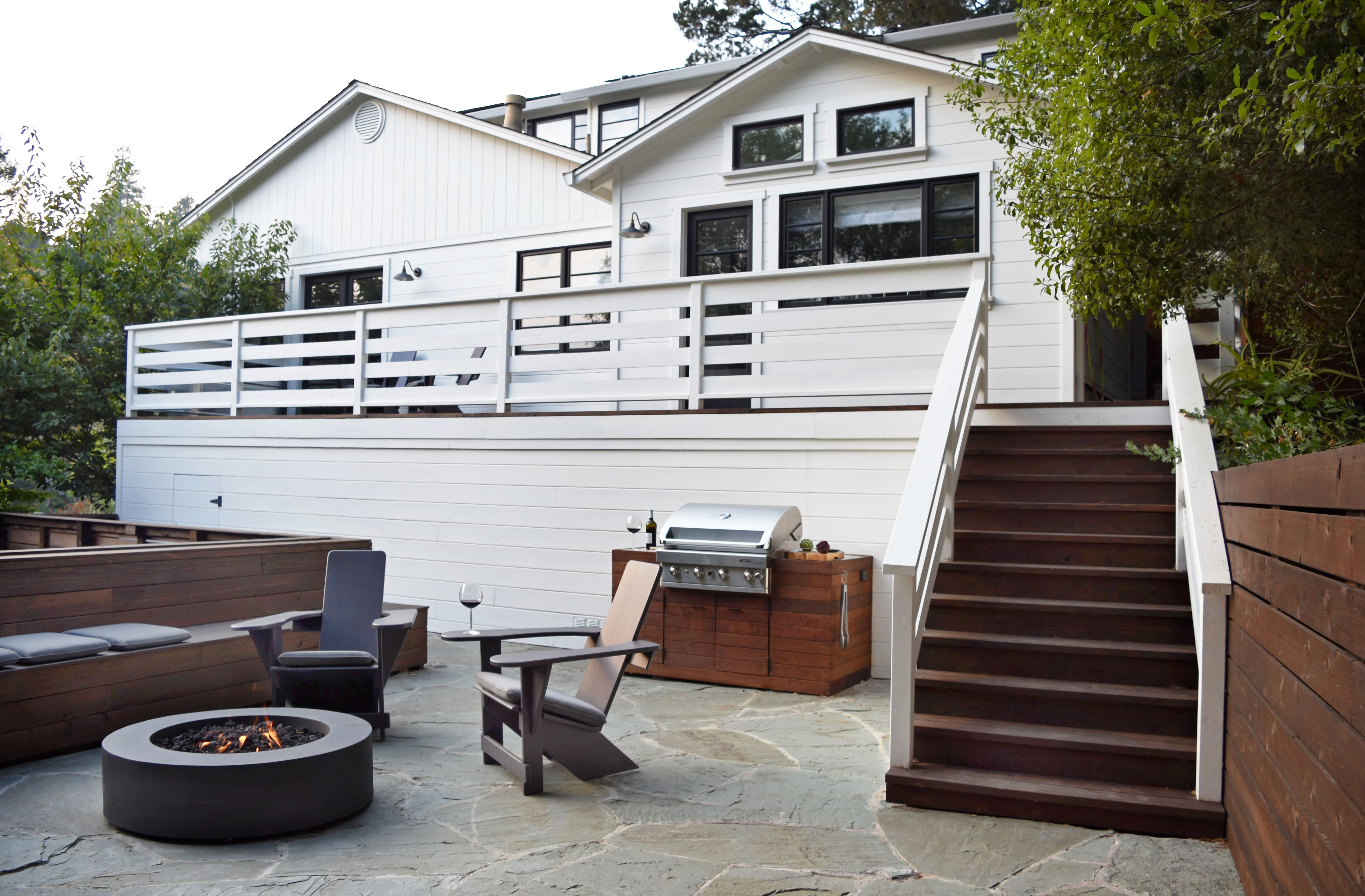 white hosue with steps leading to stone patio