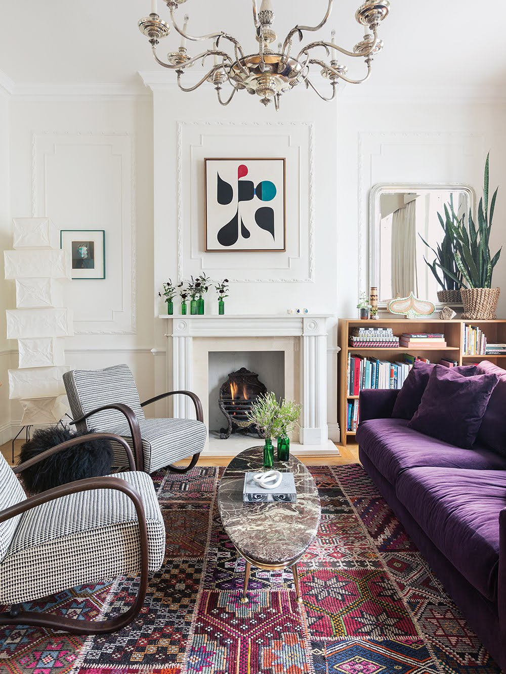 living room with purple couch and chairs