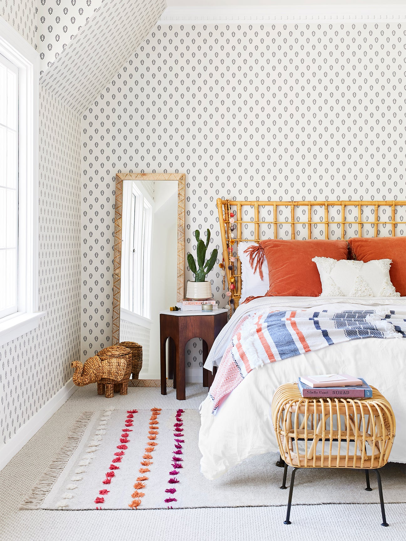 light and airy bedroom with patterned wallpaper