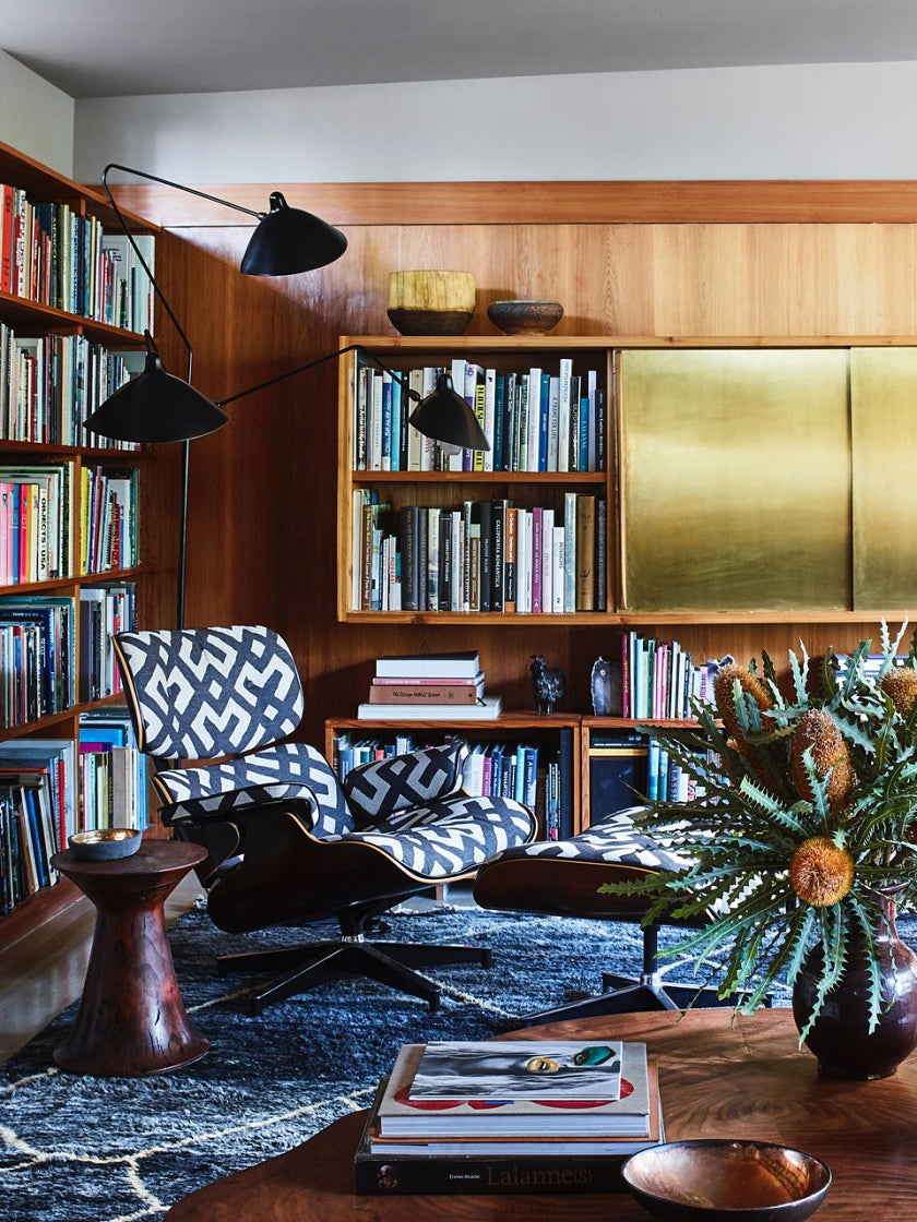 mid-century living room with brass cabinets