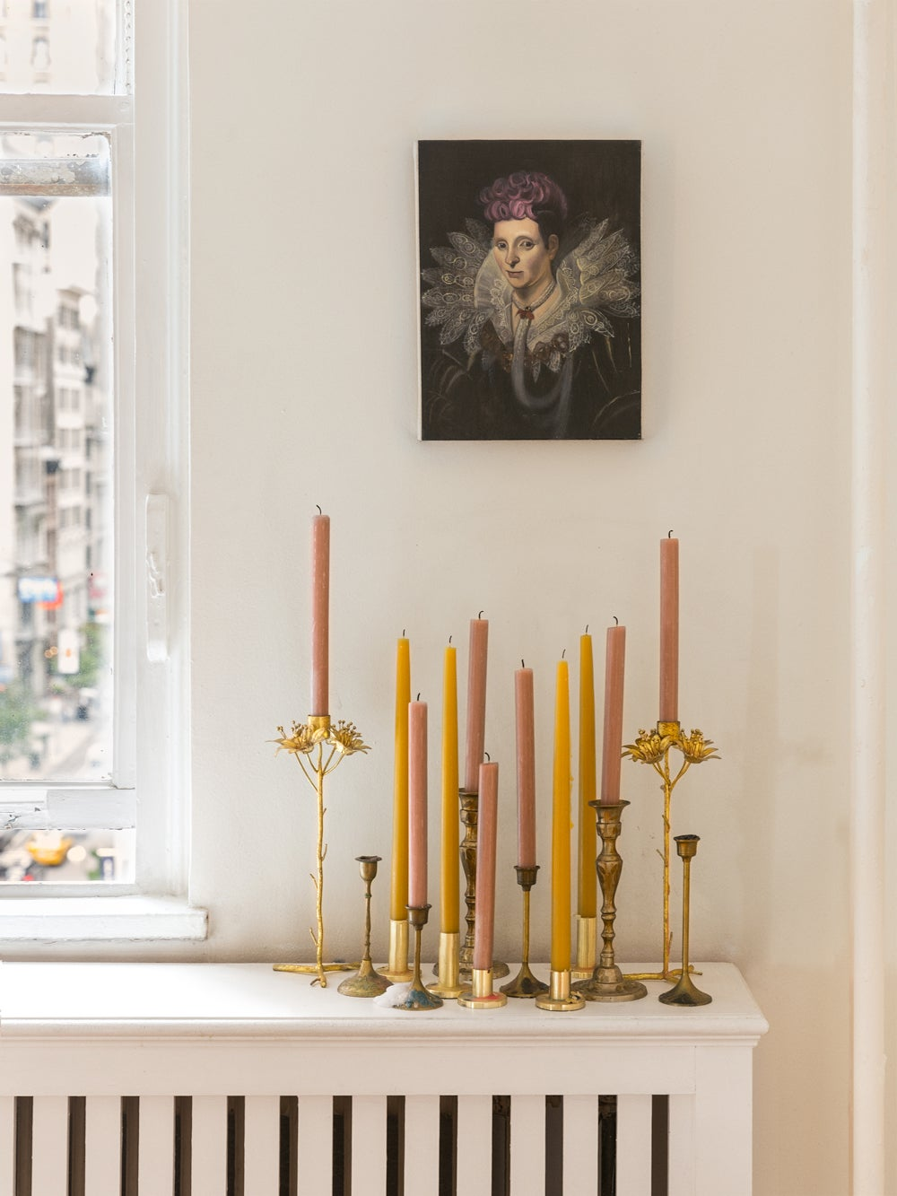 Taper candles on a ledge