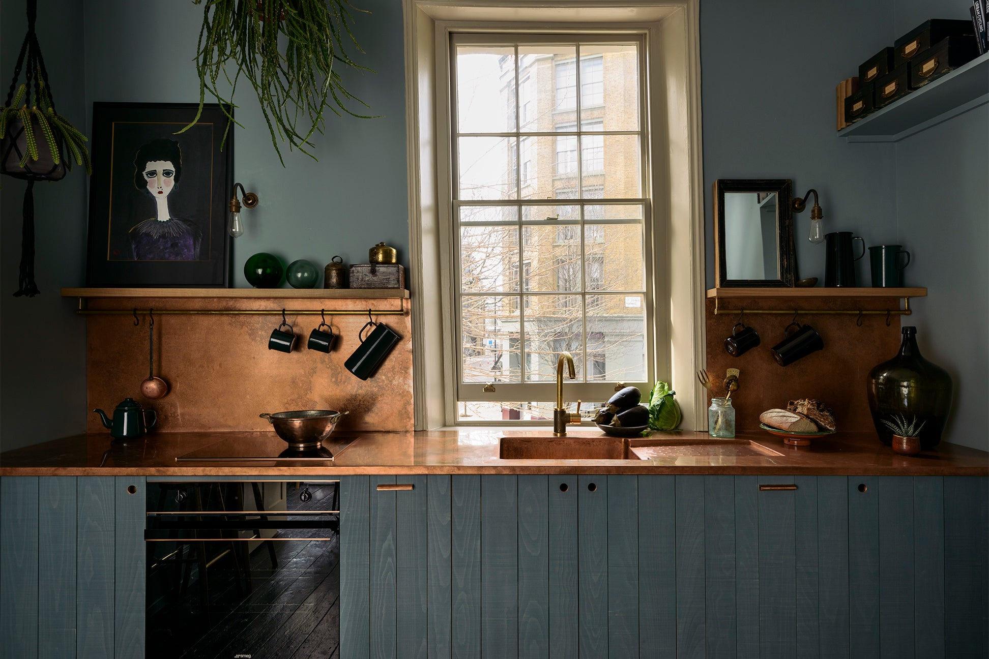 teal kitchen cabinets with copper counter