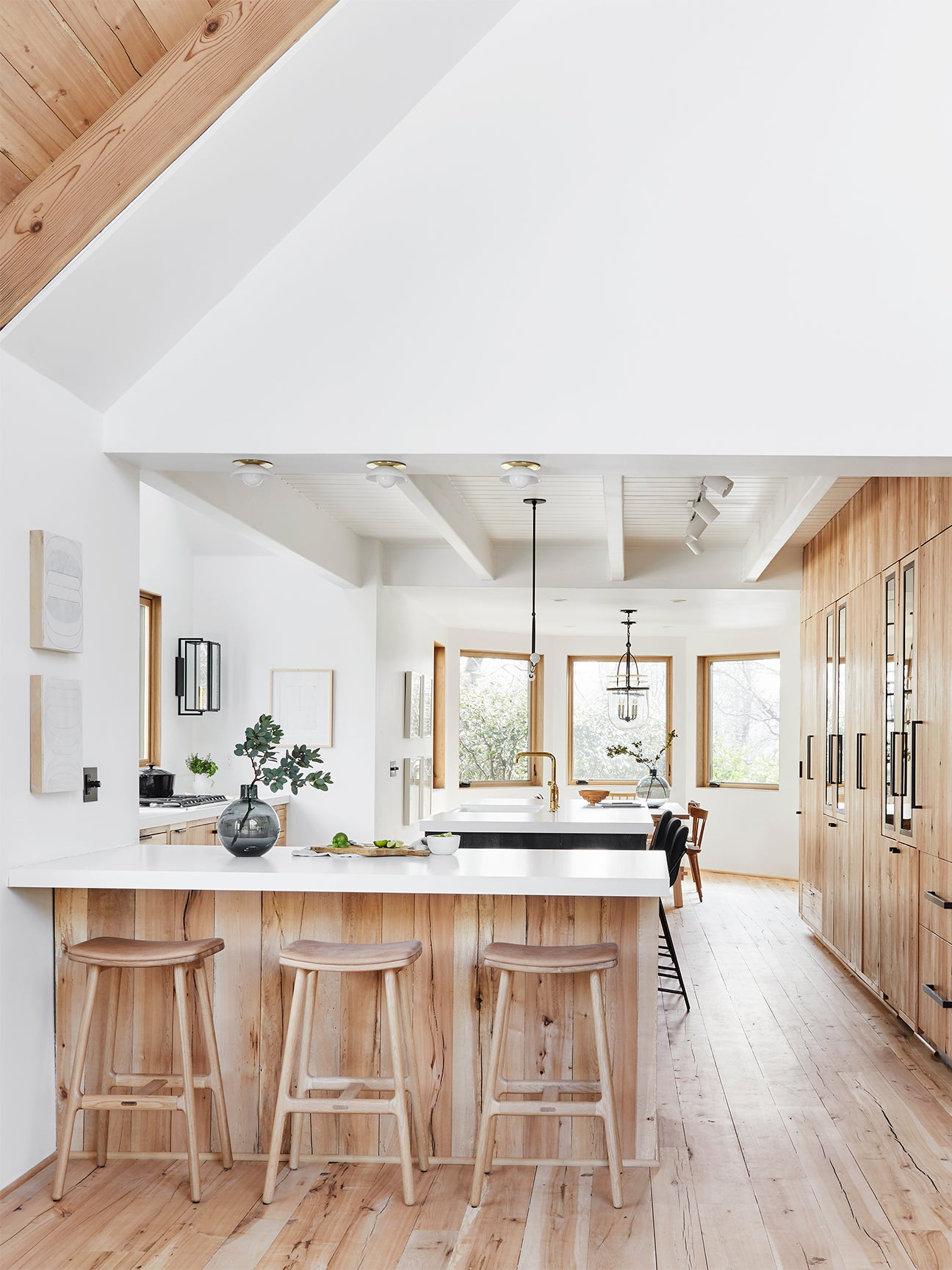 white kitchen with raw wood cabinetry