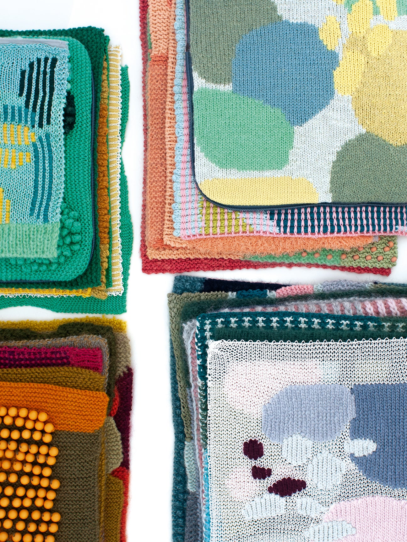 Colorful mixed knitted samples in varied patterns