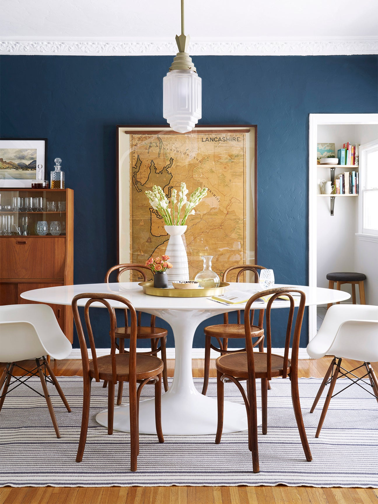 blue wall dining room with wooden chairs