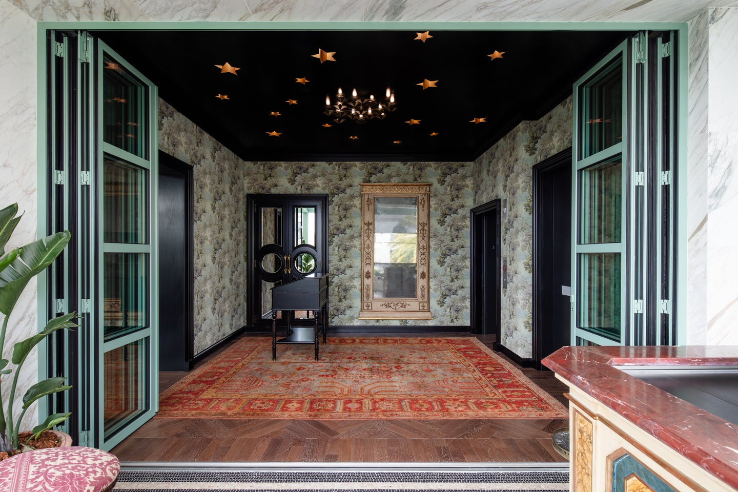 black ceiling entryway with red antique rug