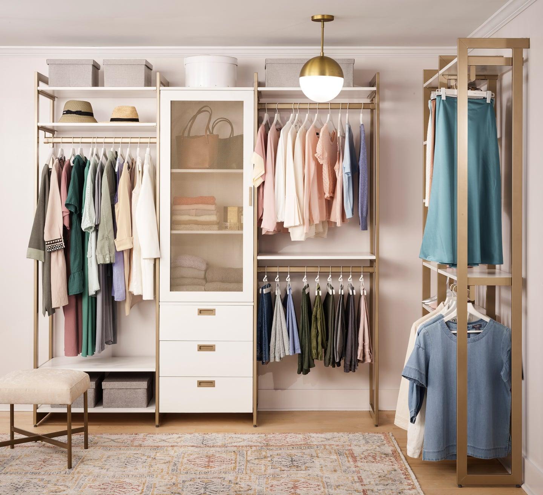 white and brass closet unit