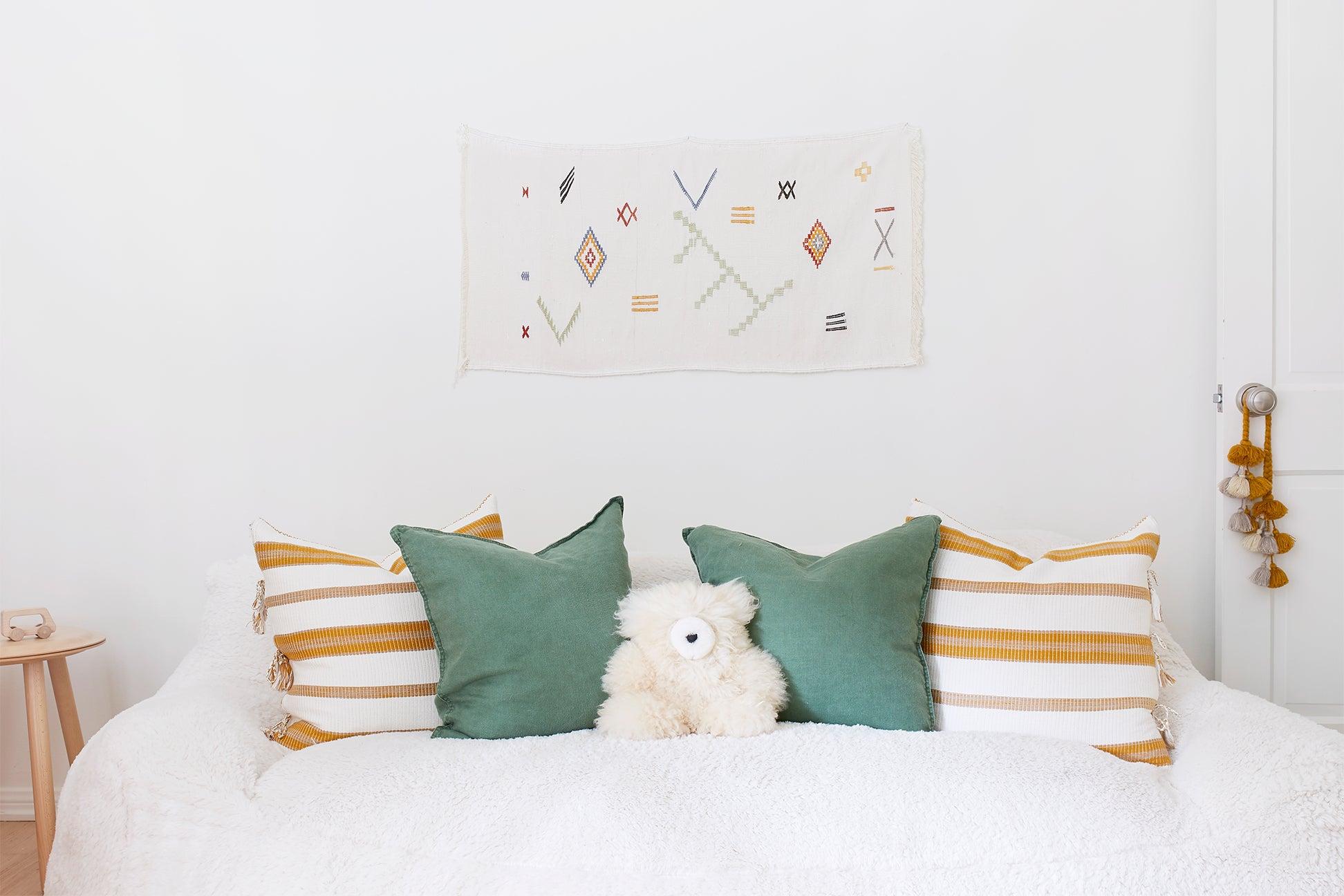 cozy white sofa with striped pillows