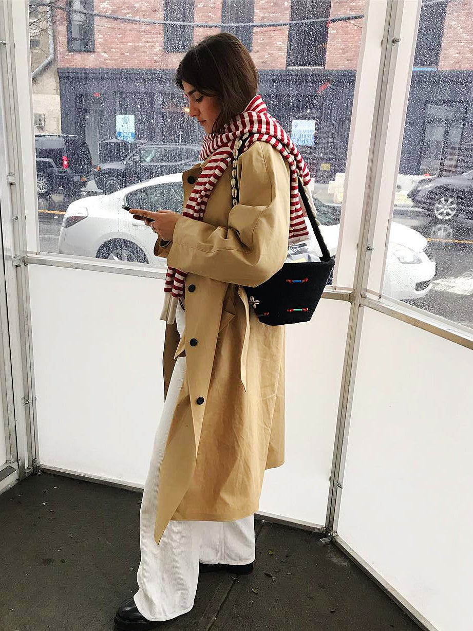 girl in trench coat and red scarf