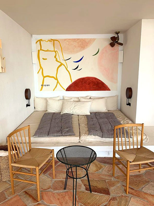 bedroom with colorful mural